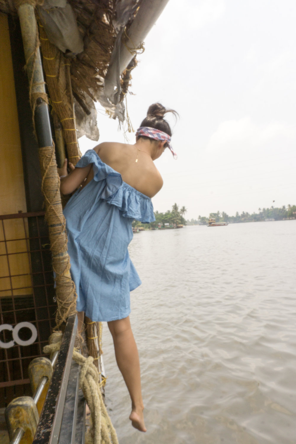 Hanging off a houseboat near Kumarkom