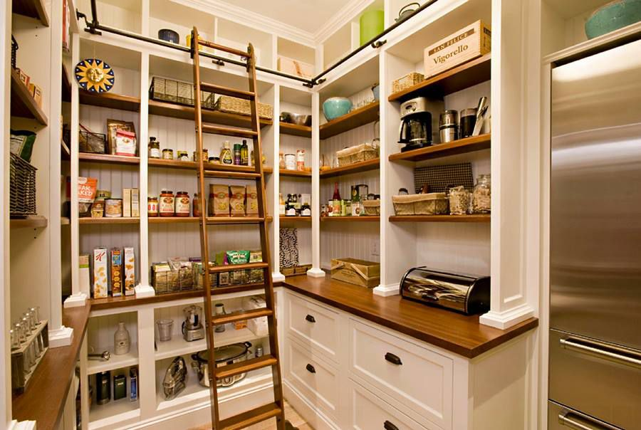 This pantry not only has a ladder to reach the top shelf with a rail support for extra care but also has a some dedicated counter space for storing & cutting bread, food wrapping and other small tasks!