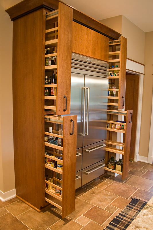 6 SLIDE OUT KITCHEN STORAGE RACKS CALLS FOR EASY ACCESS ...