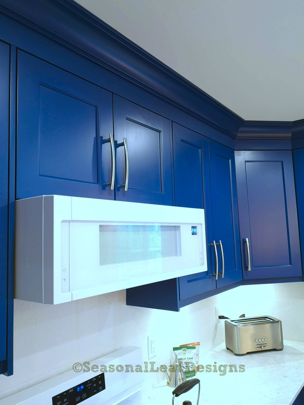 Kitchen Design blue cabinet crown molding