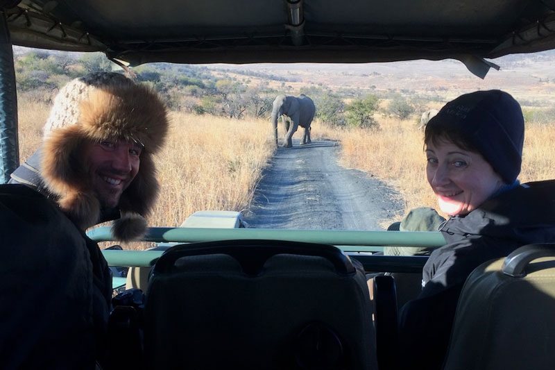 Andreas and Catherine watching an elephant stroll towards them on safari.