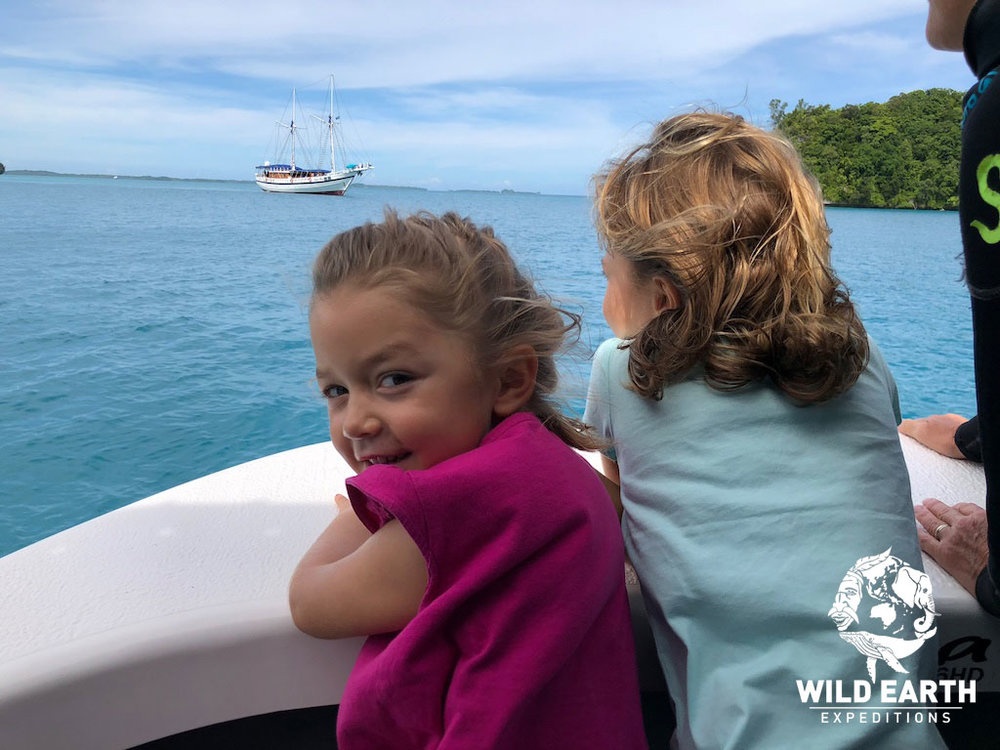Coco and Estelle enjoy a boat ride through the Rock Islands - Palau - Wild Earth Expeditions
