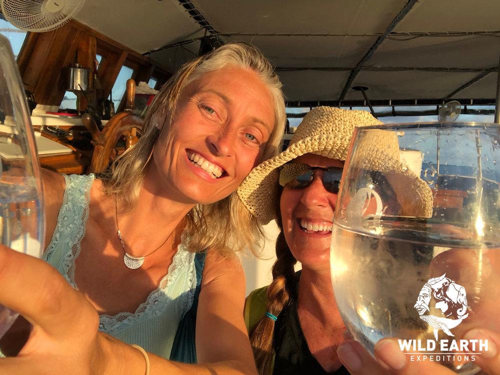 Natalia & Robin enjoy a 'sundowner' - Palau - Wild Earth Expeditions
