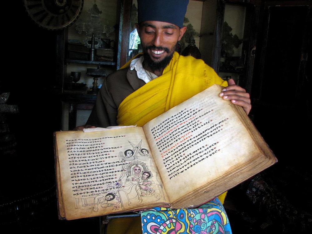 ETH_Lake-Tana-Azwa-Mariam-Monastery-Monk-w-Manuscript-©-Dinkesh-Ethiopia-Tours1.jpg