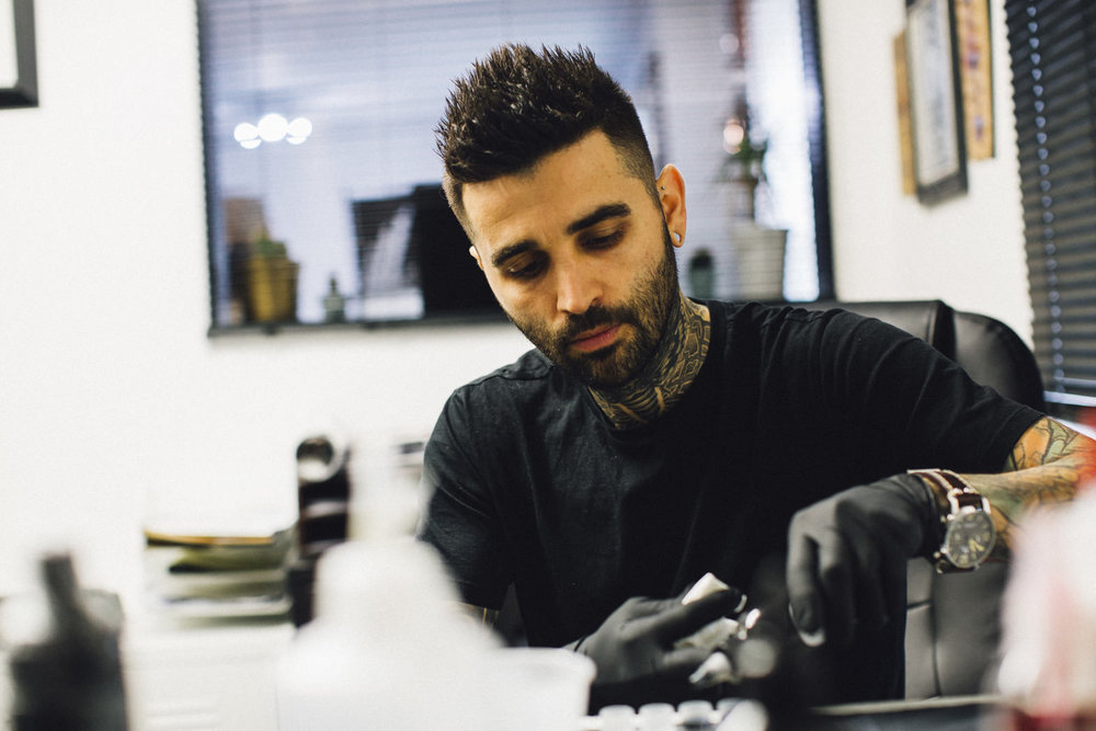 Radu -   Tattoo Artist - he likes to swear in Romanian & complain about the music but he loves what he does with passion & is the Master of Photo Realism.