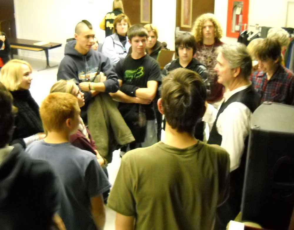 Spencer talks with Montana high school students after his performance.