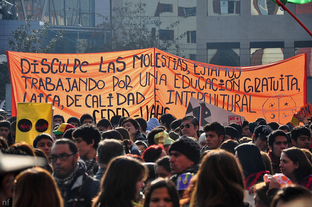 "Chilean student protesters demand for an ""education that is free, secular, high-quality, and intercultural."" Source: Flickr Creative Commons via  Nicolás Fuentes ."