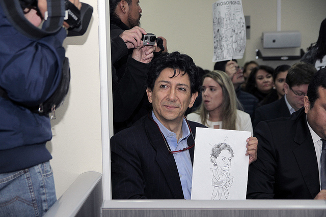 Bonil poses with a cartoon. Source: Flickr Creative Commons via  Agencia de Noticias ANDES .