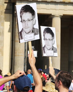 "Protesters support Edward Snowden at a ""Stop Watching Us"" protest in Berlin. Photo by: Markus Winkler"