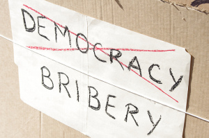 Many anti-corruption activists see corruption as a deterioration of democracy itself. Source: Flickr Creative Commons via  Meiling .