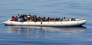 An inflatable hard bottom craft carrying some 87 would be immigrant mainly from Somalia is pictured 26 miles from Lampedusa on June 15, 2008. Source: Flickr Creative Commons via  NoBorder Network .