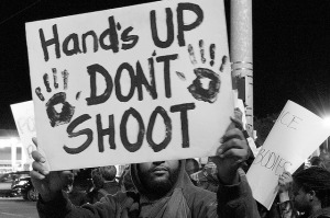 Protester in Memphis, TN responds to the killing of Michael Brown in Ferguson, MO. Source: Flickr Creative Commons via  Chris Wieland .