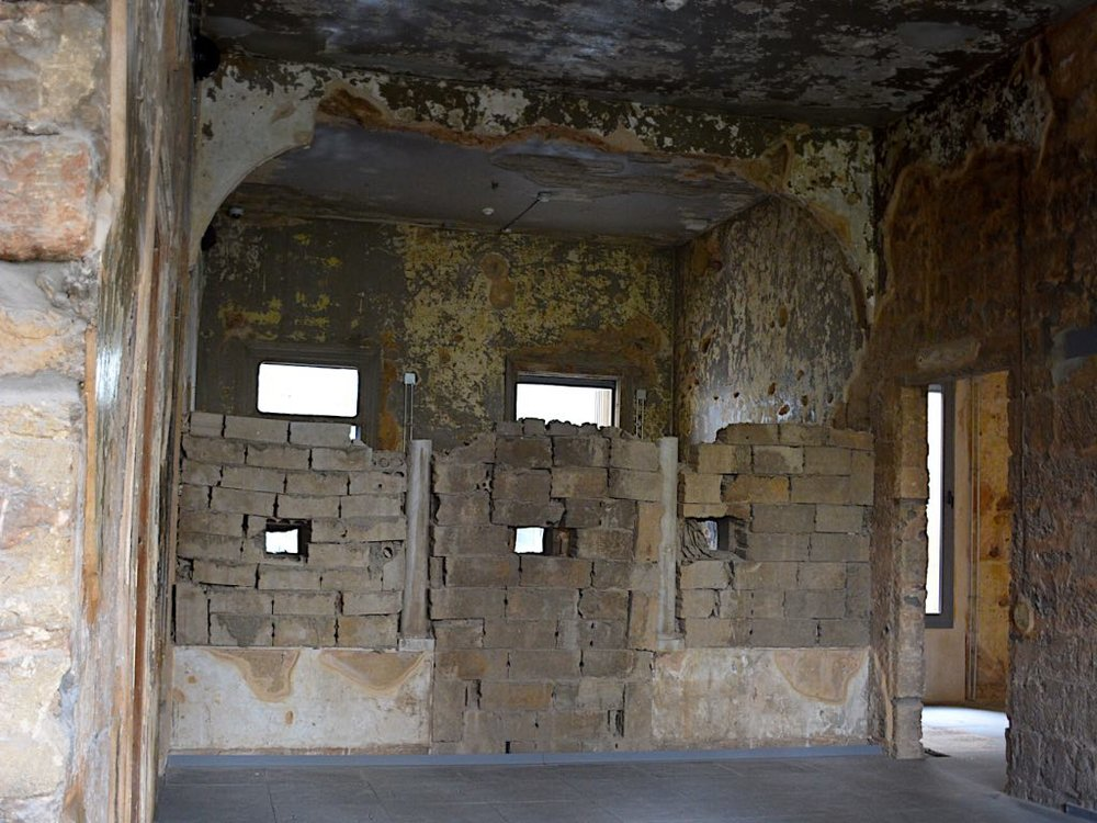 The killing holes constructed by snipers in one of the rooms of Beit Barakat. (Photo by Krizna Gomez)