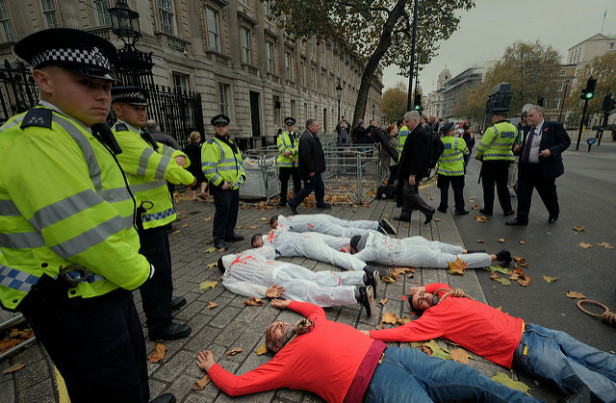 Egyptians stage a protest die-in, blocking Downing Street, during Sisi's visit to London. Photo by: Alisdare Hickson