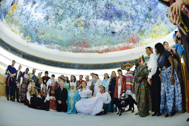 Delegates of the UN Human Rights Council, wearing the traditional dress of their respective countries, pose for a group photo after the panel the topics Human Rights and climate change. Photo by: Jean-Marc Ferré