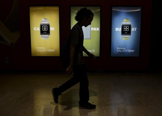 A man walks past a Samsung billboard at Kuala Lumpur convention centre in Malaysia. Photograph: Ismail/NurPhoto/Alamy