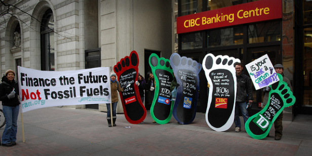 On December 4th, The Rainforest Action Network helped to create an action in downtown Calgary highlighting the impact on climate change of individual investments in the 5 major Canadian banks. Photo by: ItzaFineDay