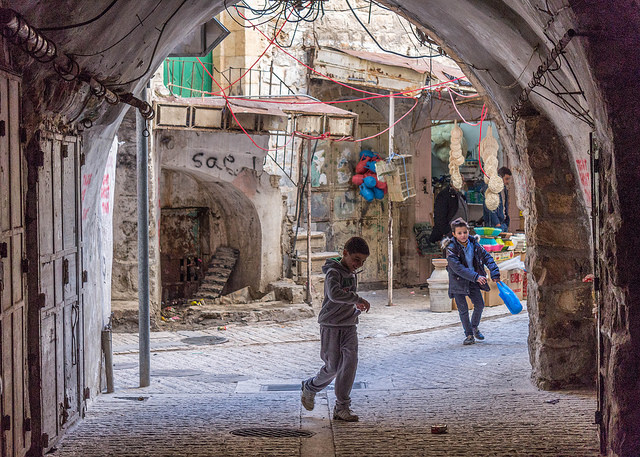 Children play in Hebron. One of the most volatile places in the Westbank, Hebron is patrolled by IDF soldiers protecting the roughly 400 Israeli settlers living in the middle of the Palestinian old city. Photo by: Ronan Shenhav
