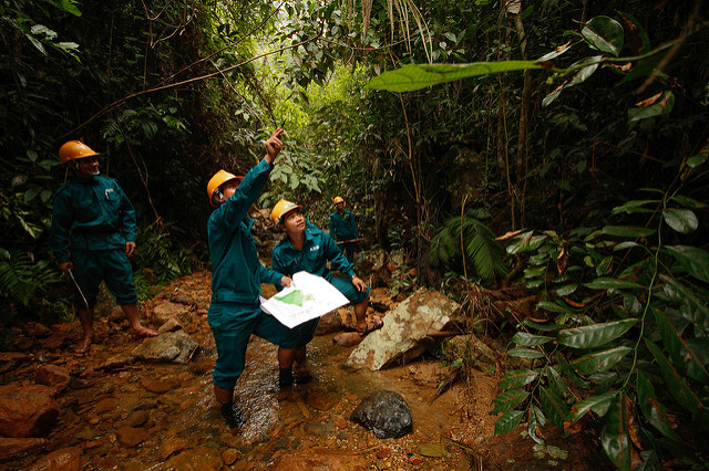 Patrollers working in the jungles around Macooih, Vietnam. Each patrol group is composed of community members who are tasked with maintaining the general well-being of the forest. This is made possible through the Poverty and Environment Fund with the approach known as payment for forest ecosystem services. Photo by: Asian Development Bank.