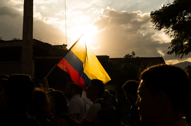 Colombians waive their flag during a demonstration. Photo: Leon Hernandez