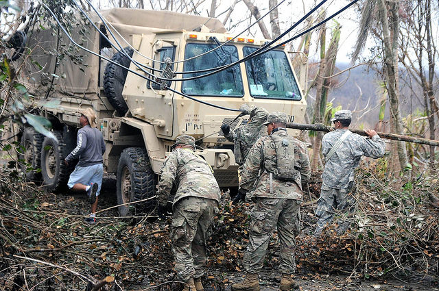 National Guard officials, alongside residents of the municipality of Cayey, conduct a route clearing mission after the destruction left by Hurricane Maria. Photo: The National Guard