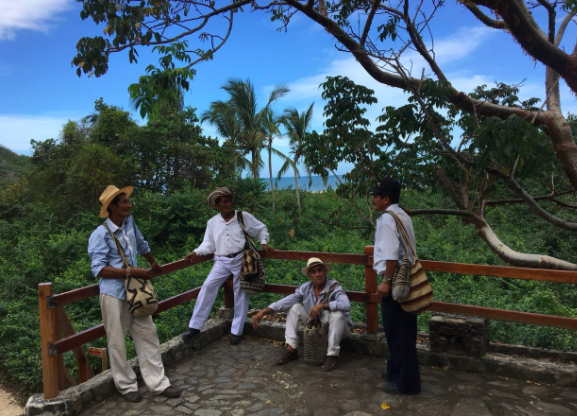 Photo of the  Mamos , indigenous authorities, in the Tayrona Park at the end of our long journey on the beaches of the Caribbean Coast. The Mamos accompanied us throughout the workshop guaranteeing our spiritual well-being. Photo by: Angélica Cuevas.