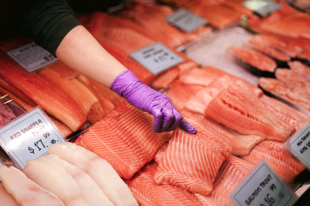 Farmed salmon is given artificial colorant to encourage purchase by consumers. Photo Source:    Colin Czerwinski    on    Unsplash   .