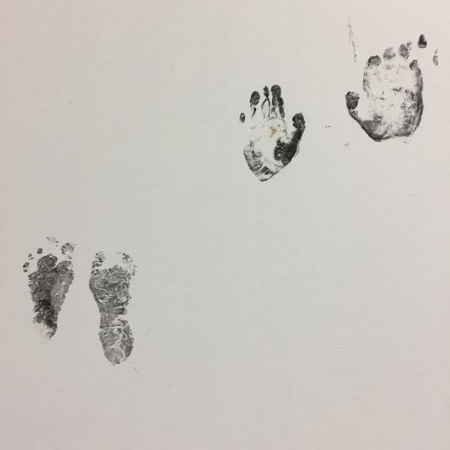 The tiny hand and footprints of Chelsea's sweet baby.