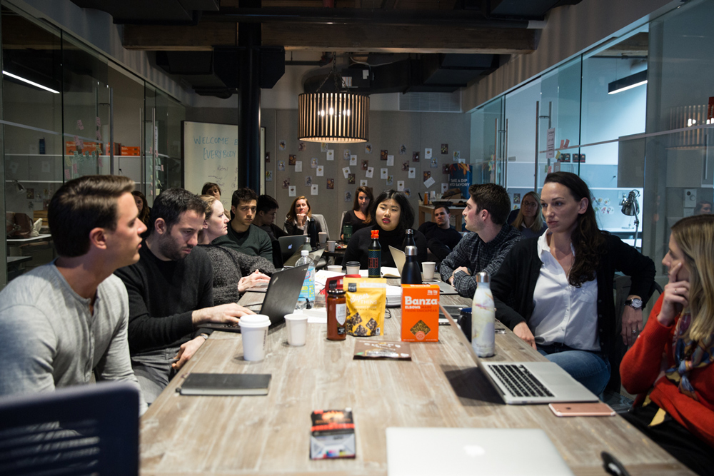 a group of professionals around a conference table, having a discussion