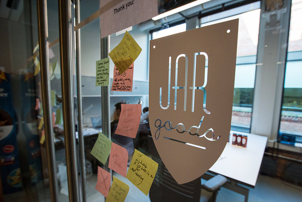 Photo of Jar Goods logo and brightly colored post-it notes
