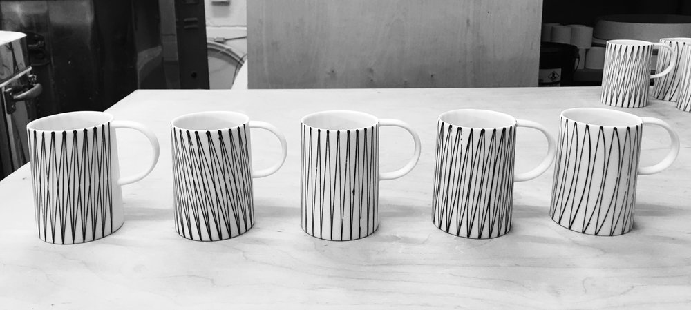 "new mug patterns, single diamonds, zag, leaf and sail Examples of new patterns developed for the current Heals order. Developments often happen unexpectedly in an unplanned way but once they begin to happen they often occur in multiples. These new mug decorations show this. I particularly like the simple ""sail"" pattern on the right. It's got an appealing painterly quality which is new. Let us know what you think."
