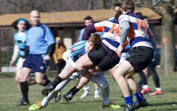 Photo courtesy of Jordin Hartwig A member of the EC Rugby Club tackles an opponent during a game in the successful fall campaign.