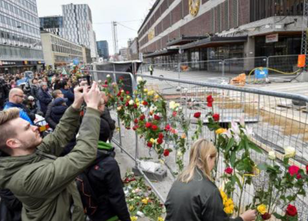 Civilians gather on Saturday, April 8 to mourn the four people killed in the terrorist attack carried out on a busy pedestrian street in Stockholm, Sweden.  Internet Photo