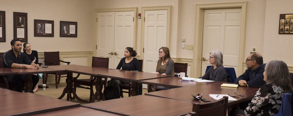 EC students Kenneth Edison, Estrella Vargas and Emma Kaminski are the only students in attendance at the ECIC review committee's student feedback session in the President's dining room on Wednesday, March 29. Photo by Stefan Carlson