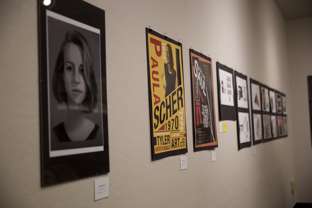 Artwork created by EC students hangs on the walls in the Founders' Lounge of the Frick Center.Photo by Stefan Carlson