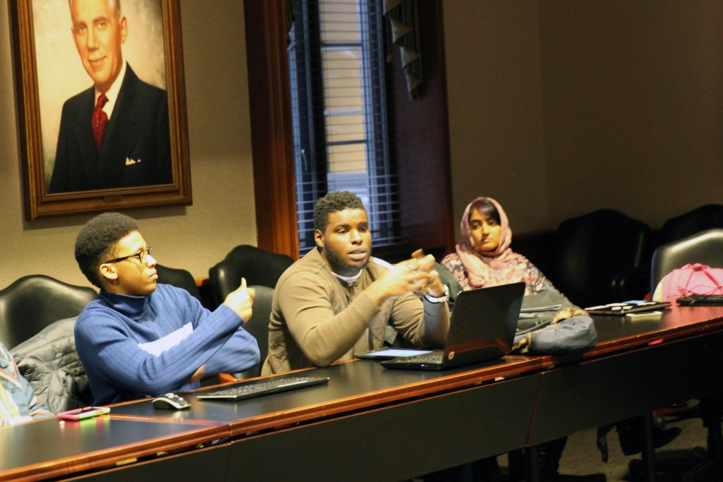 Callen Williams, Perode Charles, and Uroosa Nafasat speak about their identity at an event cohosted by BSU and MSA.
