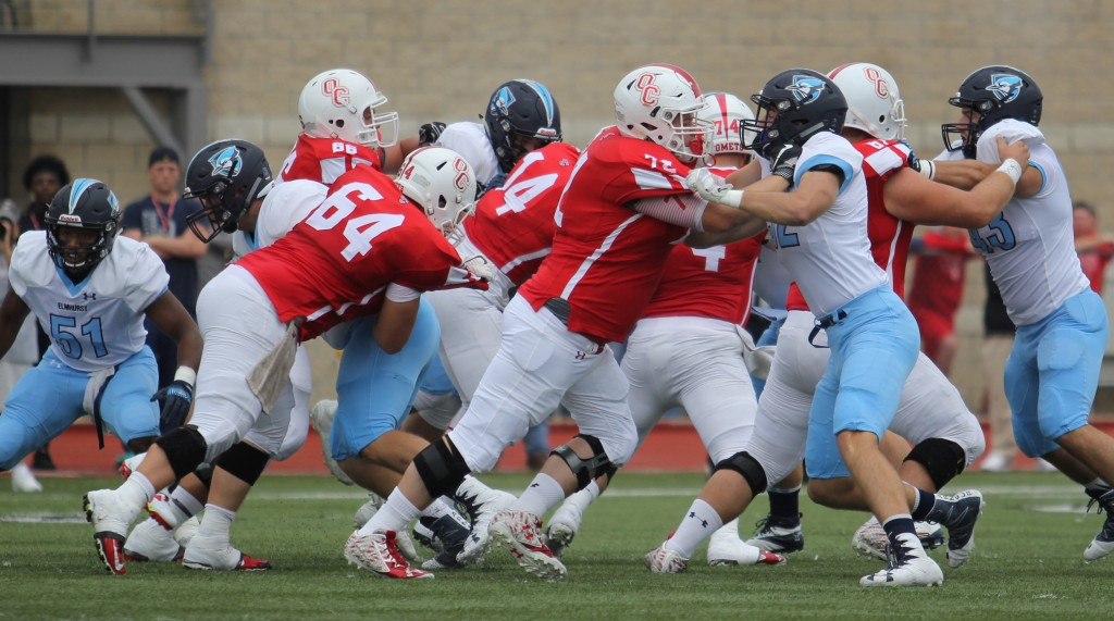 Defensive and offensive lines collide at the beginning of a play at the EC vs. Olivet football game on Saturday, Sept. 10. (Photo by Kivin Woods)