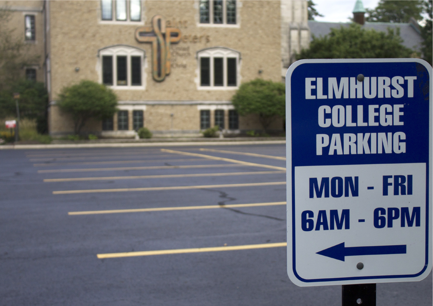 Signs display parking available to Elmhurst College students at St. Peter's Church in Elmhurst. (Photo by Stefan Carlson)