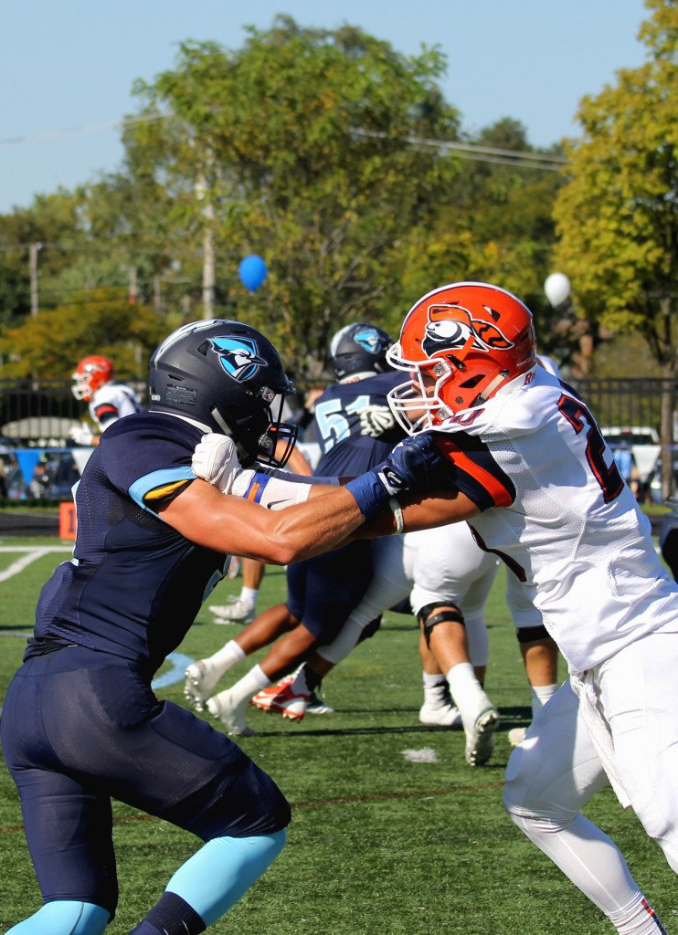 An EC lineman clashes with a John Carroll University player on Saturday, Oct. 8 (Photo by Kivin Woods)