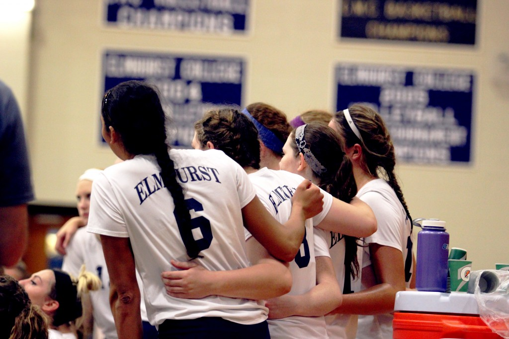 Senior Nava Reed and sophomores Molly Brennan and Molly McGrath embrace each other and teammates on Senior Night at EC. (File Photo)