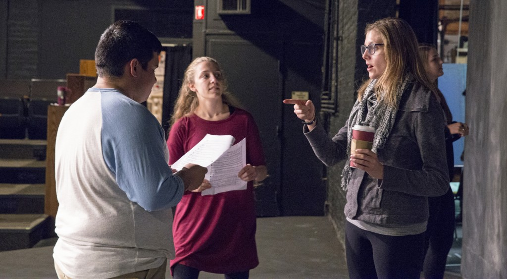 "Laura Matthews, an EC alum and adjunct faculty member, gives directions to senior Daniel Sanchez and sophomore Marissa Banker, two of the actors from the play ""I and You."" (Photo by Stefan Carlson)"