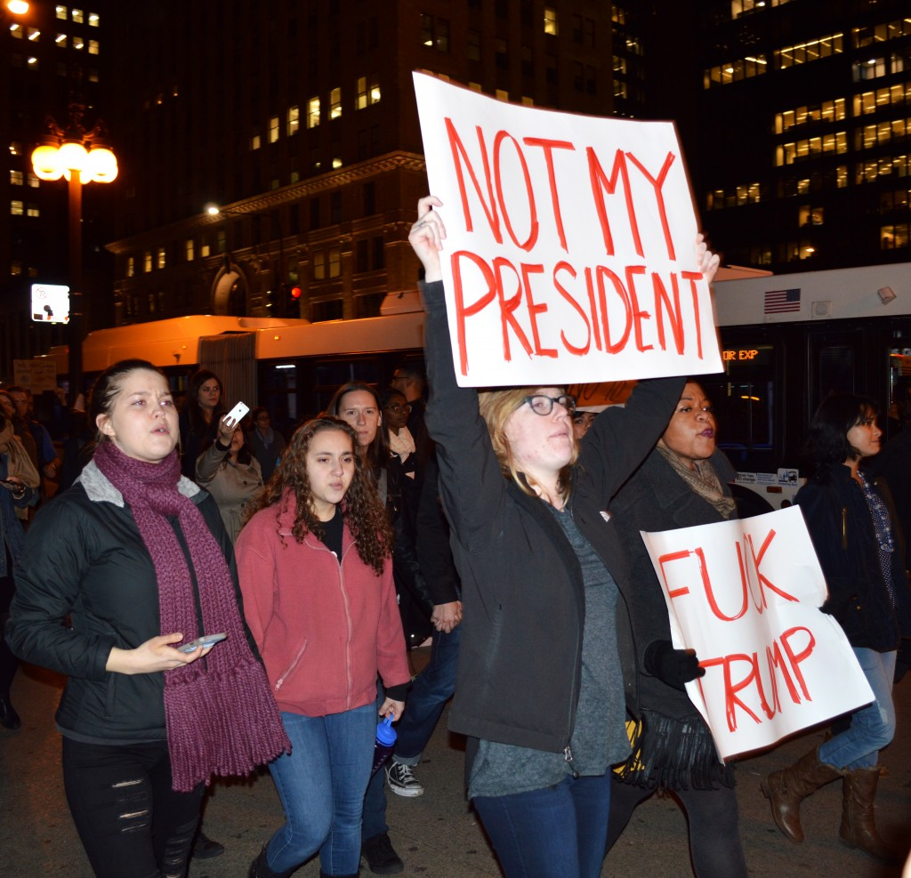 Protesters wielding anti-Trump signs march down Michigan Avenue in downtown Chicago on Wednesday, Nov. 9 (Photo by Victoria Martin)
