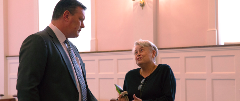 Dianne Chambers, professor of English, speaks to President VanAken after a mandatory faculty and staff meeting in the Hammerschmidt Memorial Chapel on Thursday, Oct. 27. (Photo by Stefan Carlson)