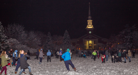 EC students throw snowballs at fellow classmates on the Mall as part of a tradition celebrating the year's first snowfall. (Photo by Stefan Carlson)