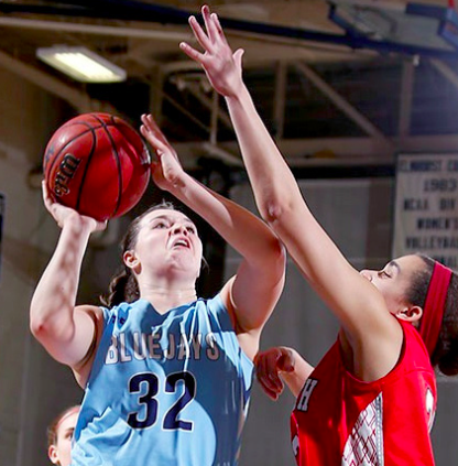 Junior guard/forward Mikaela Eppard attempts a contested layup on Satur- day, Dec. 3. (Internet Photo)