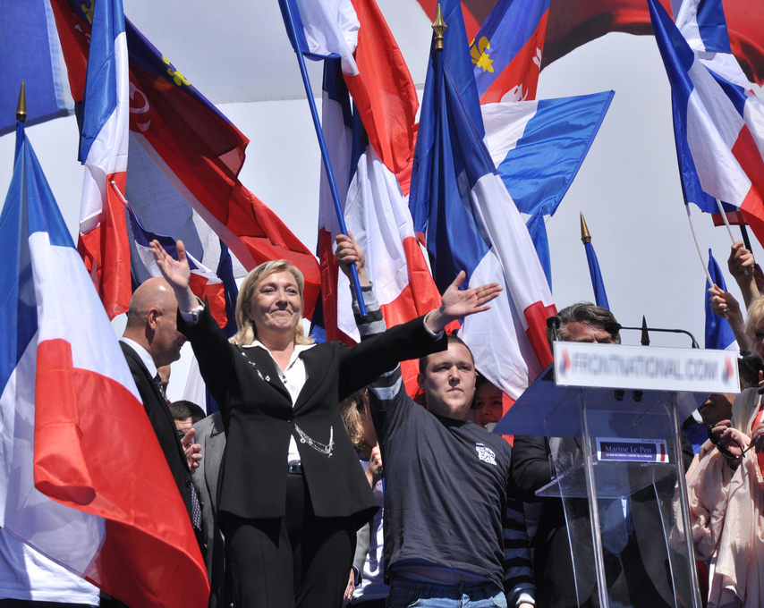Internet photo Far-right French Presidential candidate Marine Le Pen cheers with crowd at rally.