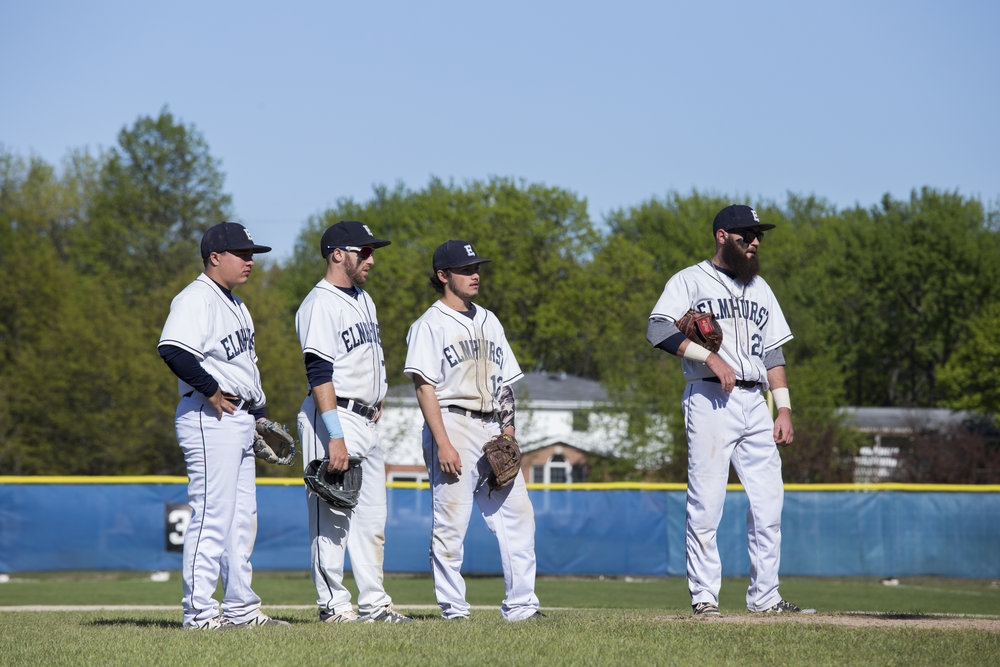 Bluejay infielders Evan Berliner, Brandon Kressner, Trey Compton and Austin MacMillan (left to right) look on as the the team makes a pitching change during their season finale at Butterfield Park.Photo by Stefan Carlson