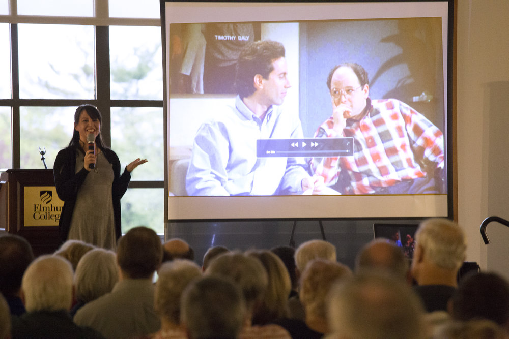 """Jennifer Armstrong shows clips of various """"Seinfeld"""" episodes during her lecture """"Seinfeldia: How a Show About Nothing Changed Everything"""" in Founders on Tuesday, May 2. Photo by Stefan Carlson"""