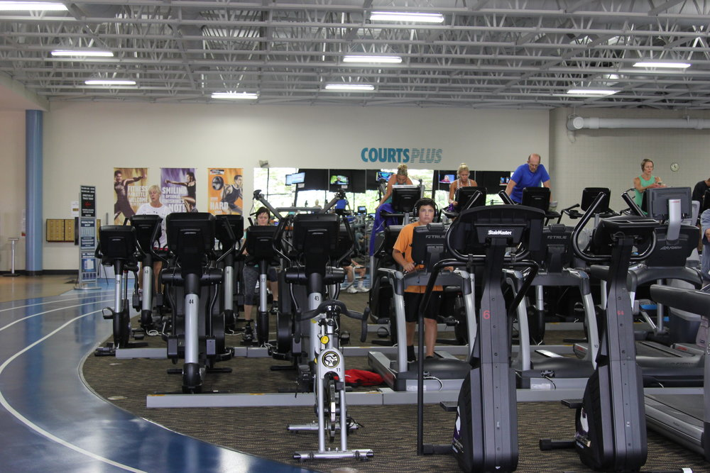 Photo by Cole Sheeks   Courts Plus' large selection of cardio equipment surrounded by its indoor track.