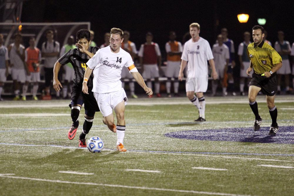 File Photo Matt McNamara kicks the ball down field during a game from last season.
